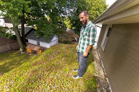 Scott Harris standing on the green roof covering the back of his house